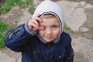 little boy wearing a hooded jacket